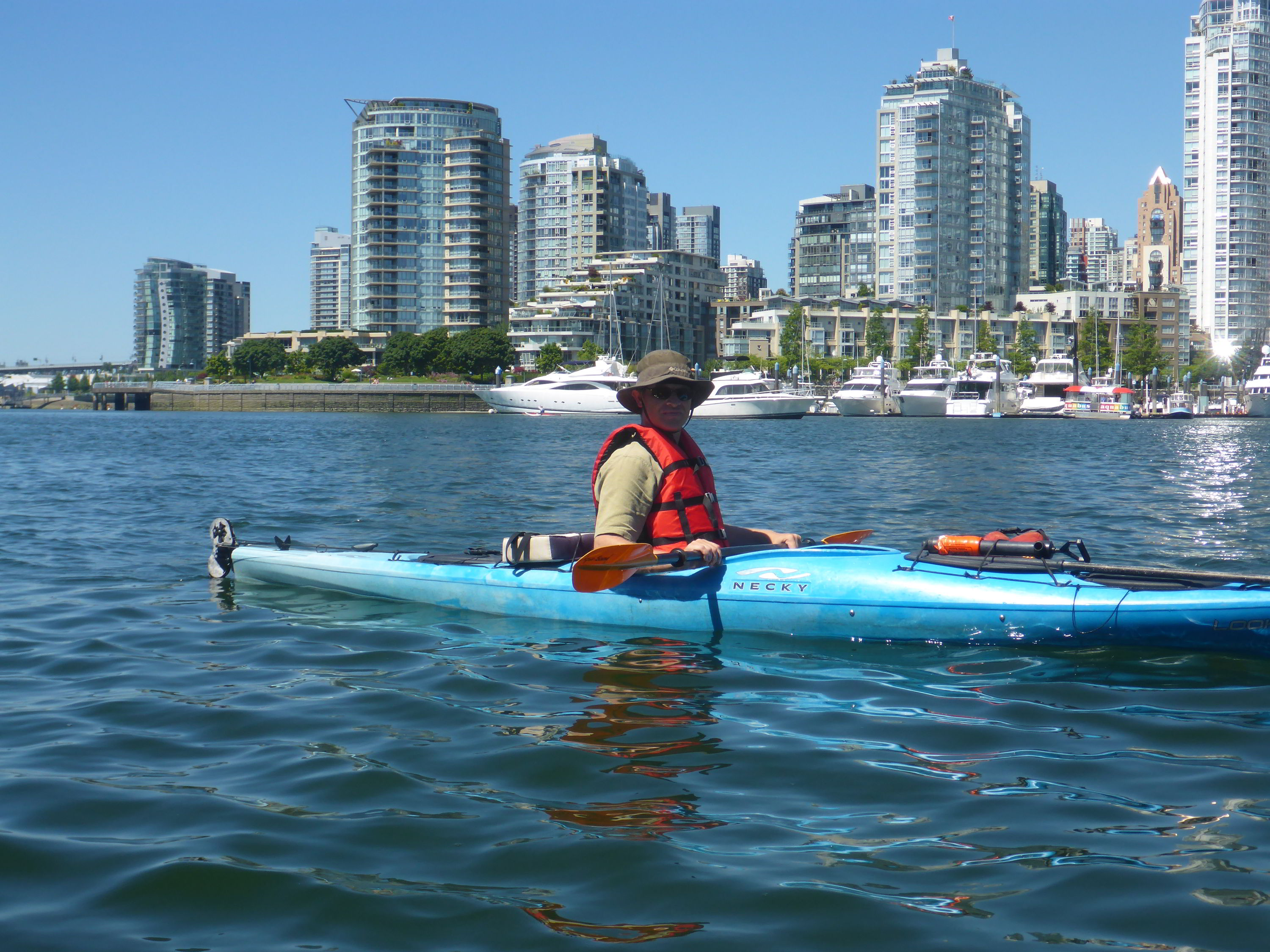 Kayaking along the waterfront, Vancouver, British Columbia, Canada
